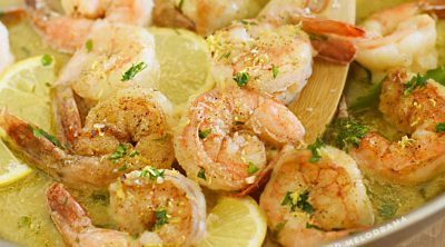 shrimp scampi with lemon and parsley in a skillet