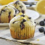 glazed lemon blueberry muffins on the table