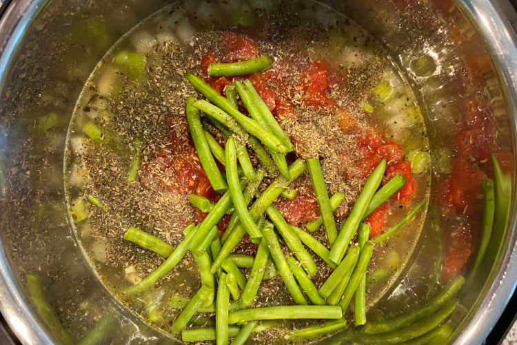 soup ingredients and fresh green beans in instant pot