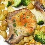 baked ranch pork chops with potatoes and broccoli on a sheet pan