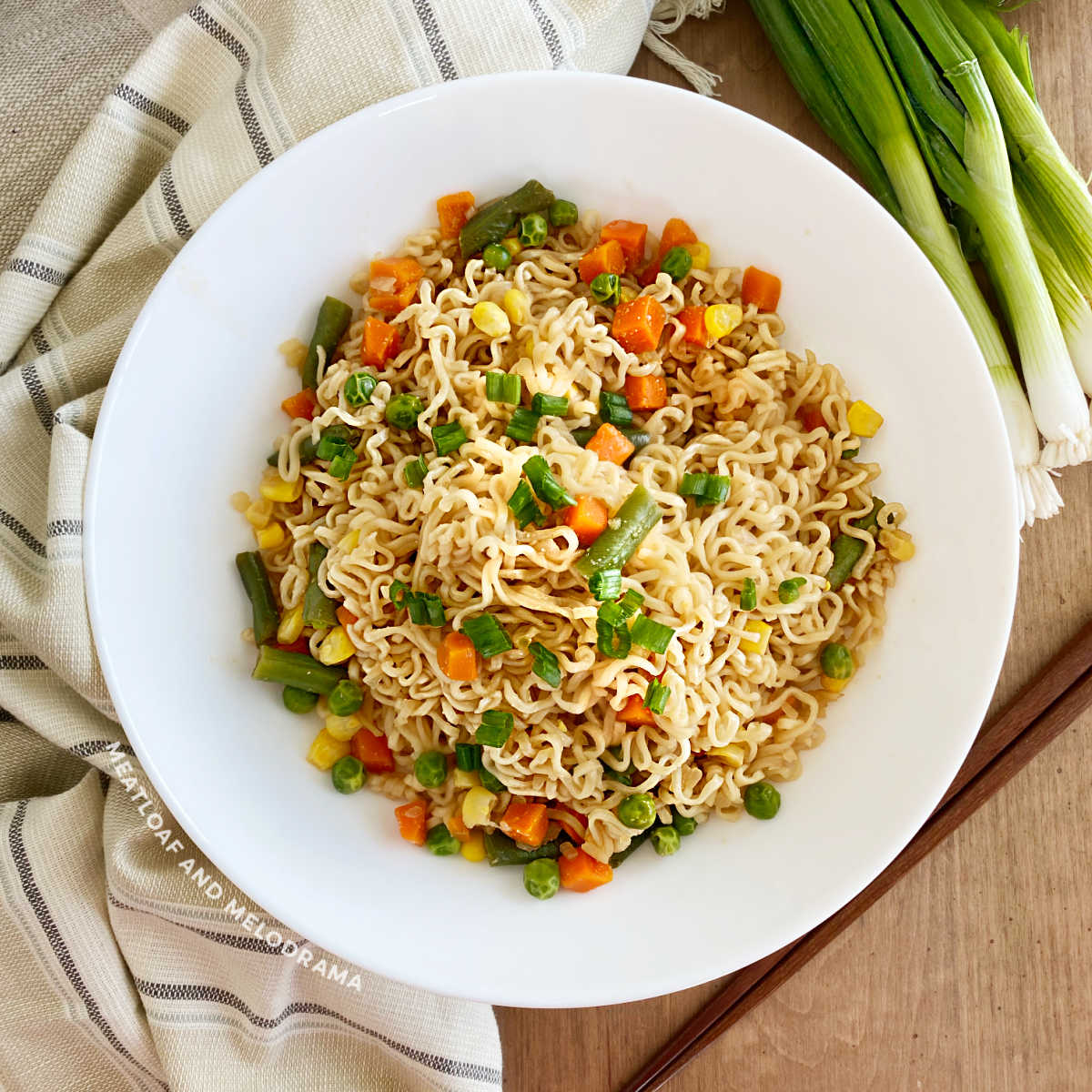 ramen stir fry with noodles and vegetables in a white bowl