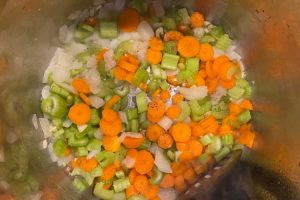 saute chopped onions, carrots and celery in pressure cooker