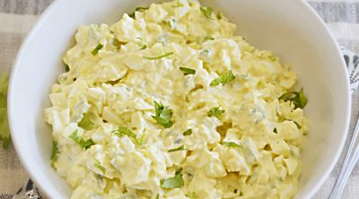 simple egg salad in a white serving bowl
