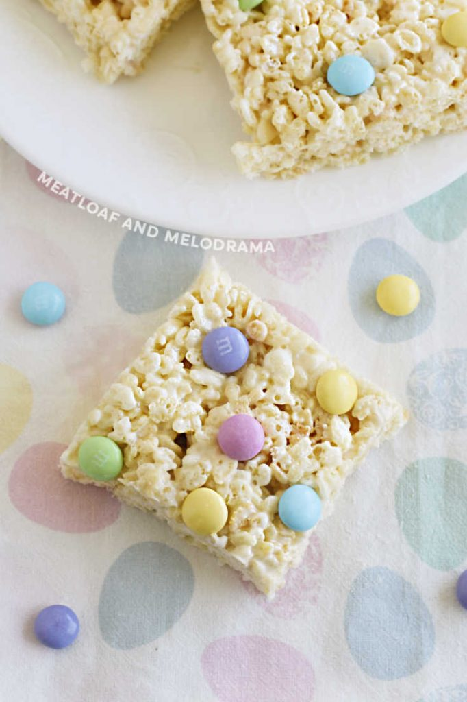 spring marshmallow rice krispies bar with pastel m and m's on pastel napkin