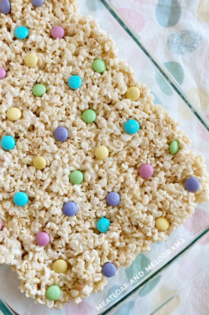 Pan of spring rice krispies treats with pastel m and m candies on top