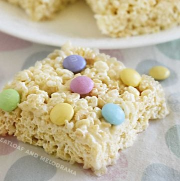 spring marshmallow rice krispie treats with pastel m and m candies on the table