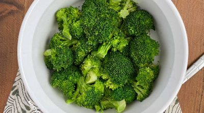 bowl of microwave broccoli with serving spoon